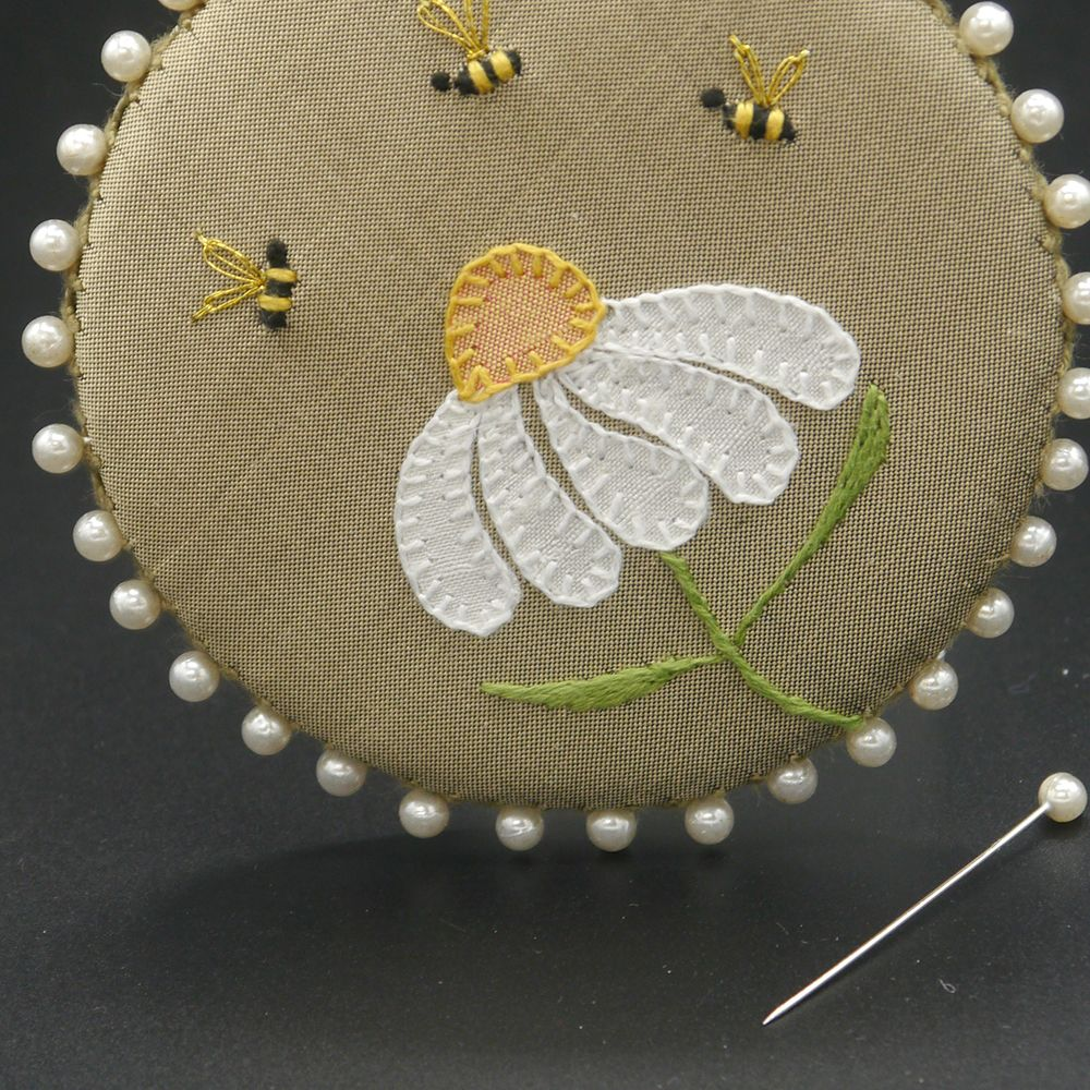 "Image Description of ""Ann Notley – pin holder with embroidered daisy and bees""."