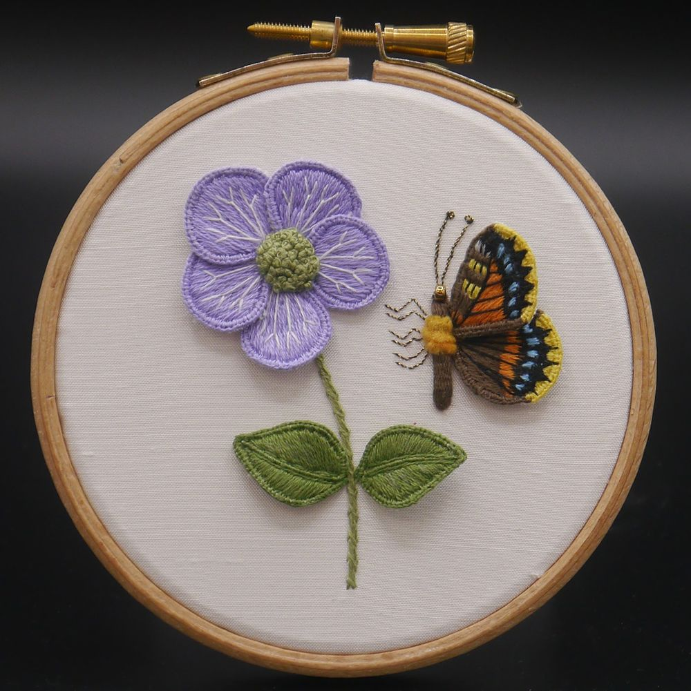 "Image Description of ""Ann Notley – hoop with stump work embroidered flower and butterfly""."
